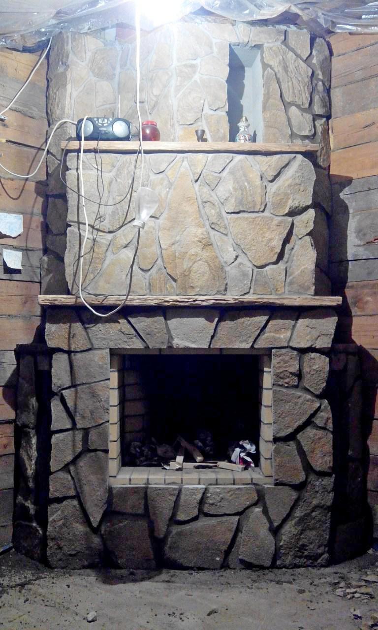 Портфолио - Угловой камин в натуральном камне